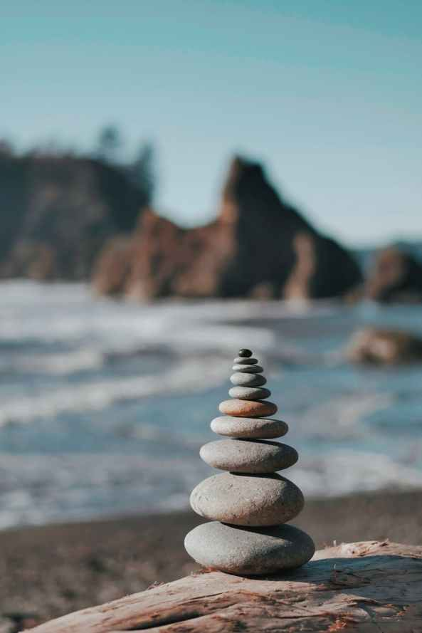 selective focus photography of balanced rocks